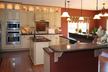 custom kitchen with excellent color tones and gathering zone