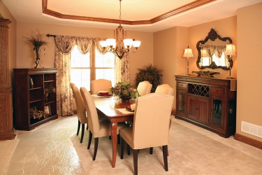 formal dining room with recessed ceiling