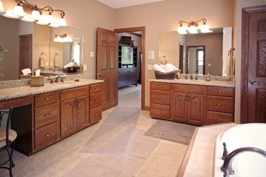master bathroom with double vanity and garden tub