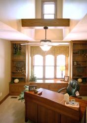 second floor office with dormer window overhead