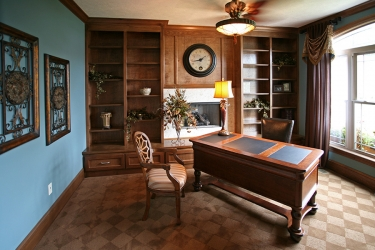 office or den with built in shelves and window view