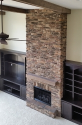 overlooking custom floor to ceiling fireplace by gatliff custom homes