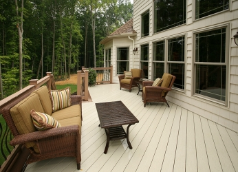 rear deck overlooking wooded area