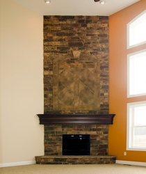 custom fireplace with stone inset by gatliff custom homes
