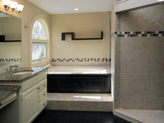 luxury bathroom featuring tile and elevated tub