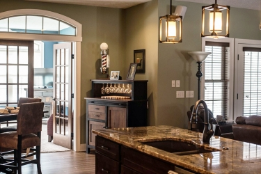 view from kitchen to sunroom custom home by gatliff custom homes