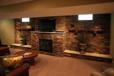view of fireplace and stonework in lower level rec area