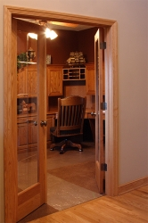 view of custom study through double doors with glass