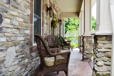 cozy porch on luxury custom home by gatliff custom builders